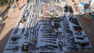 Dozens of illegal weapons seized by Israeli security forces in Bethlehem and Hebron being displayed, Aug. 23, 2016. (Courtesy of IDF Spokesperson's Unit)