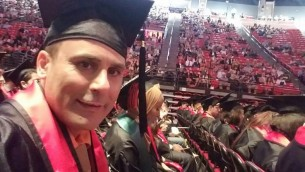 Robin Shahini during his May 2016 International Security and Conflict Resolution San Diego State University graduation ceremony. Shahini Family Photo via AP
