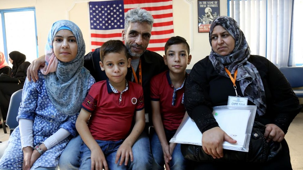 Five members of the Jouriyeh family, Syrian refugees headed to the US as part of a resettlement program. (AP Photo/Raad Adayleh)