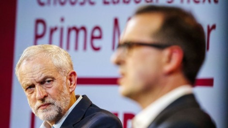 Jeremy Corbyn (left) looks on at his rival Owen Smith (right) during a leadership debate PA-28324405