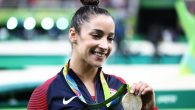 Aly Raisman posing for photographs after winning a silver medal in the all-around competition at the 2016 Rio Olympics. JTA