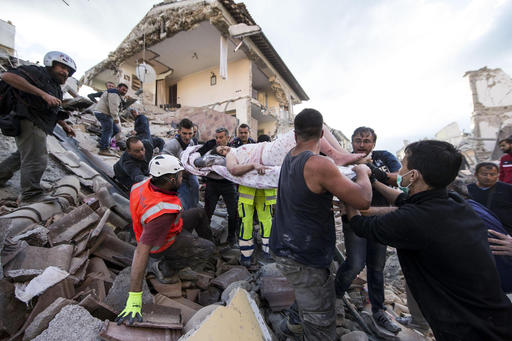 A woman is pulled out of the rubble following an earthquake in Amatrice, central Italy on Aug. 24, 2016. (Massimo Percossi/ANSA via AP)