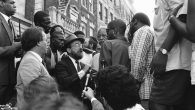 NYC Mayor David Dinkins looking on while a Hasidic Jew and a black man argue during riots in Crown Heights, BK in 1991. JTA