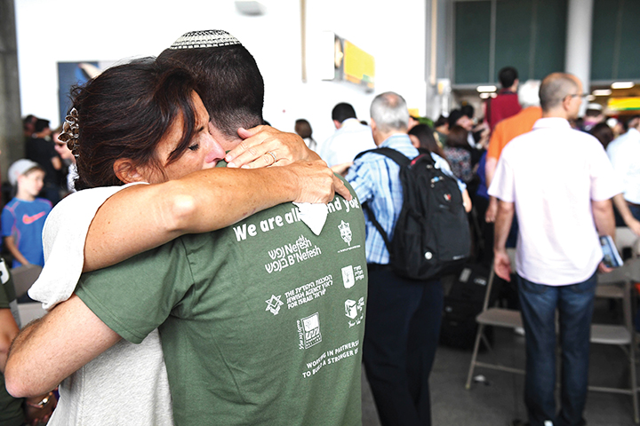Emotion runs high as a mother says goodbye to her son, off to be a soldier.