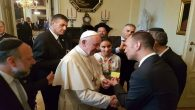 Pope Francis receiving his membership card to the Krakow Jewish Community Center from its director, Jonathan Ornstein. JTA