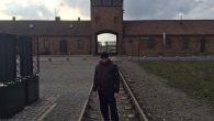 Siavosh Derakhti stands alnoe during a trip to Auschwitz with his parents. Photo courtesy of Siavosh Derakhti