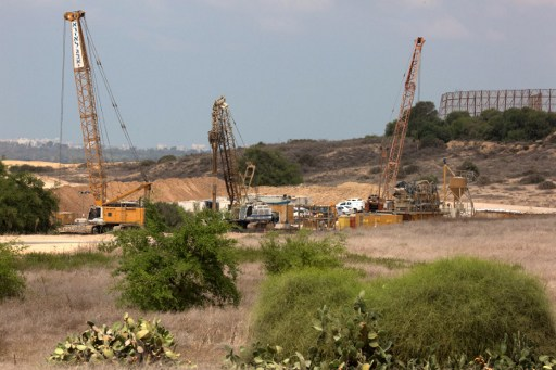 Cranes and other machinery are seen on the Israeli side of the border with Gaza Strip, on September 8, 2016. (AFP/Menahem Kahana)