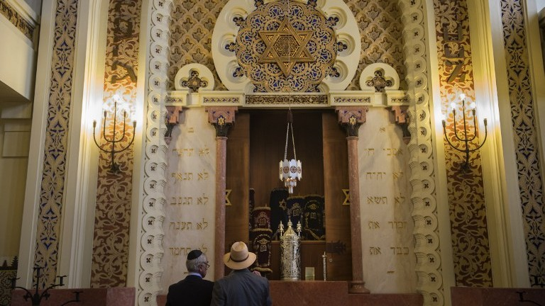 Members of the Jewish Community of Porto stand in the Kadoorie Mekor Haim Synagogue in Porto, on September 2, 2016. (AFP/Miguel Riopa)