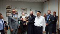 Representatives of the Jewish community of Canvey island invited to a mayor's reception at Castle Point council where they were presented with the Seal of the Council.