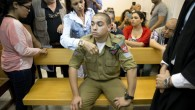 Sgt. Elor Azaria, sits inside an Israeli military court in Tel Aviv (AP Photo/Ariel Schalit. File)