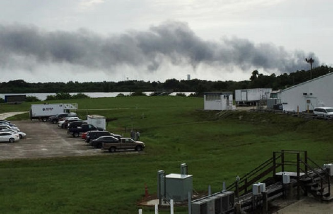 Smoke rises from a SpaceX launch site Thursday, Sept. 1, 2016, at Cape Canaveral, Florida, after an explosion during test firing destroyed a Falcon rocket and the Israeli Amos-6 satellite it was carrying. (AP Photo/Marcia Dunn)