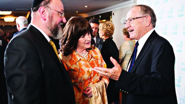 Professor Alan Dershowitz speaking with Chief Rabbi Ephraim Mirvis and his wife Valerie during the event with UJIA (Photo credit: Blake Ezra photography)