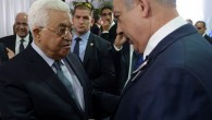 Prime Minister Benjamin Netanyahu meets with Palestinian president Mahmoud Abbas during the state funeral of late president Shimon Peres, held at Mt Herzl, in Jerusalem on September 30, 2016. (Amos Ben Gershom/GPO)