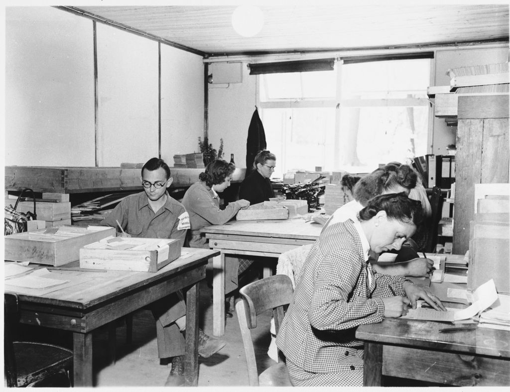 Ben Ferencz (far left) at work in the war crimes commission office established in Buchenwald. (Ben Ferencz/USHMM)