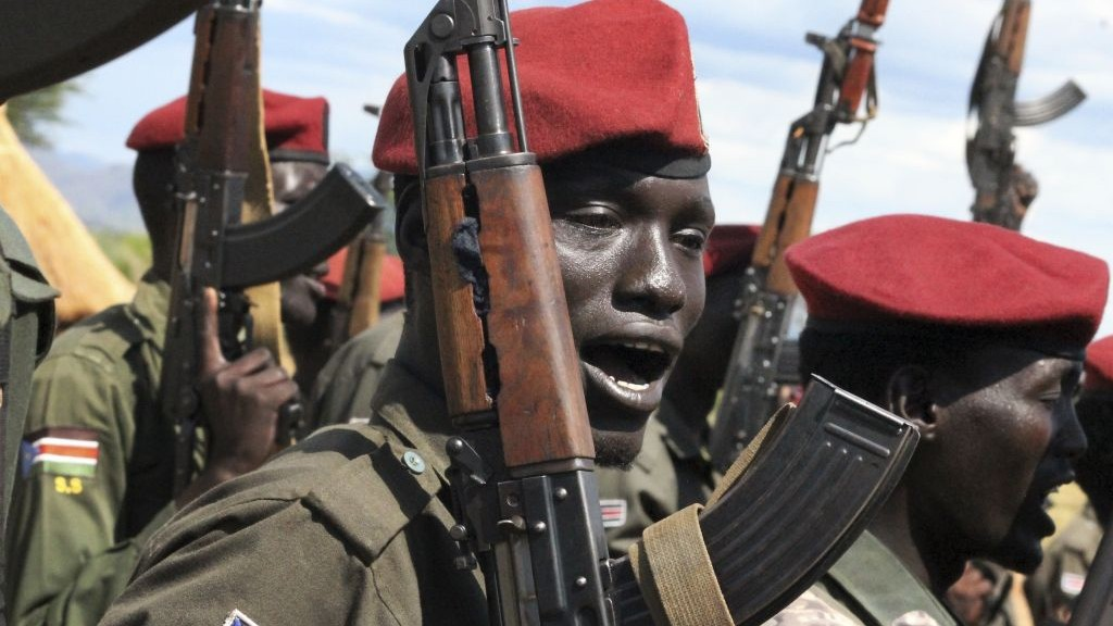 In this file photo taken April 14, 2016, government soldiers follow orders to raise their guns during a military parade in Juba, South Sudan. (AP Photo/Justin Lynch, File)