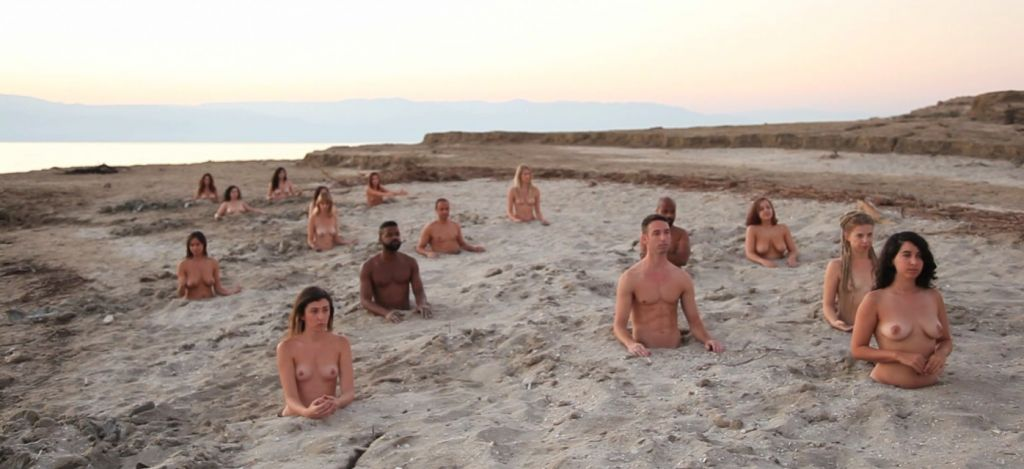 Tunick depicted his volunteers half-buried in sand to highlight the appearance of sinkholes around the Dead Sea