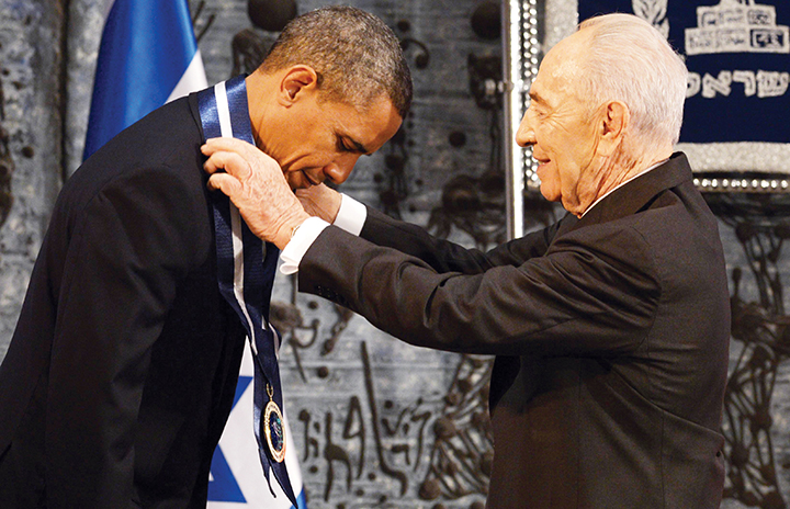 Mr. Peres gives Barak Obama the Presidential Medal in Jerusalem on March 21, 2013. (Mark Neyman/GPO/Flash90/JTA)