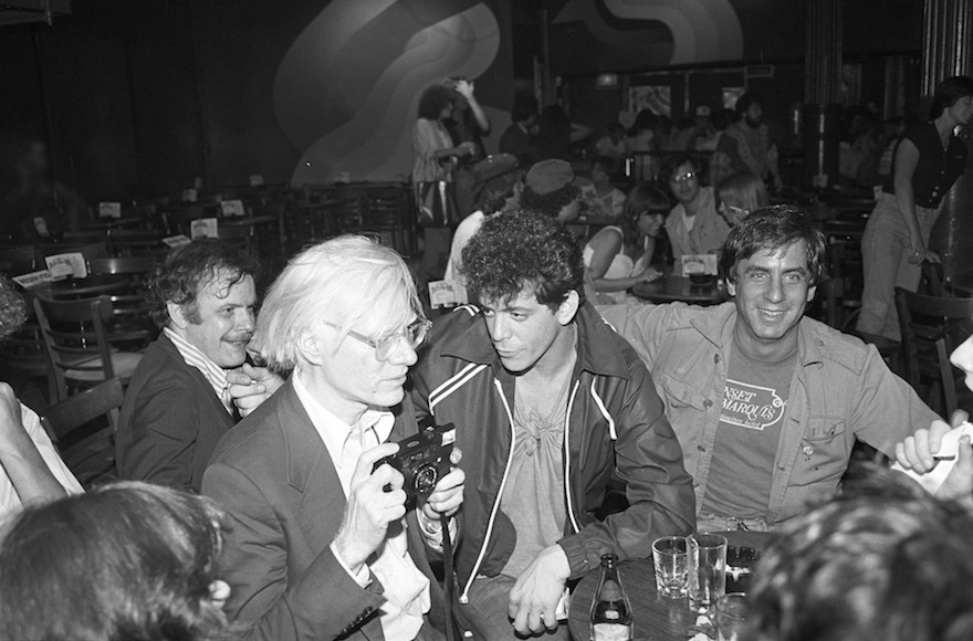 Danny Fields, right, with Andy Warhol, left, and Lou Reed, center, at a David Johansen show at the Bottom Line in New York City, July 20, 1978. (Ebet Roberts/Redferns/Getty Images/via JTA)