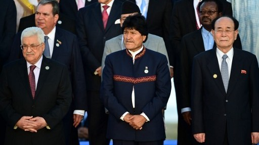 Bolivian President Evo Morales, center, North Korea's nominal head of state Kim Yong Nam, right, and Palestinian Authority President Mahmoud Abbas, left, pose during a group photo at the Non-Aligned Movement summit in Porlamar, Margarita Island, Venezuela, on September 17, 2016. (AFP Photo/Ronaldo Schemidt)