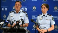 Australian Federal Police Deputy Commissioner Michael Phelan (L) and New South Wales Police Commissioner Catherine Burn address the media after two 16-year-old boys were charged with terror-related offences in Sydney on October 13, 2016. (AFP PHOTO / WILLIAM WEST)