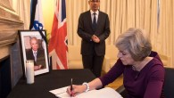 Theresa May signing the book of condolences at the Israeli Embassy in London