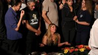 Relatives of Israeli police officer Yosef Kirma mourn during his funeral at Mt. Herzl cemetery in Jerusalem.