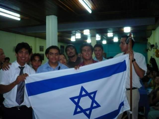 The Jews of Iquitos wave an Israeli flag. (Facebook)