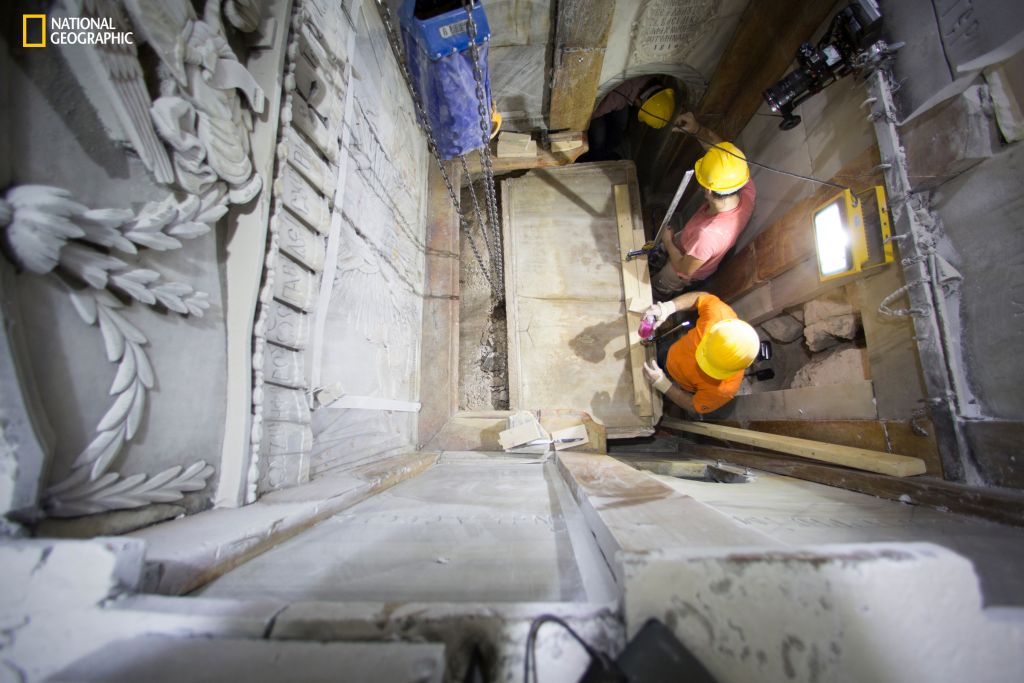 Workers remove the top marble layer of the tomb said to be of Jesus, in the Church of Holy Sepulchre in Jerusalem, October 26, 2016 (Dusan Vranic/National Geographic via AP)