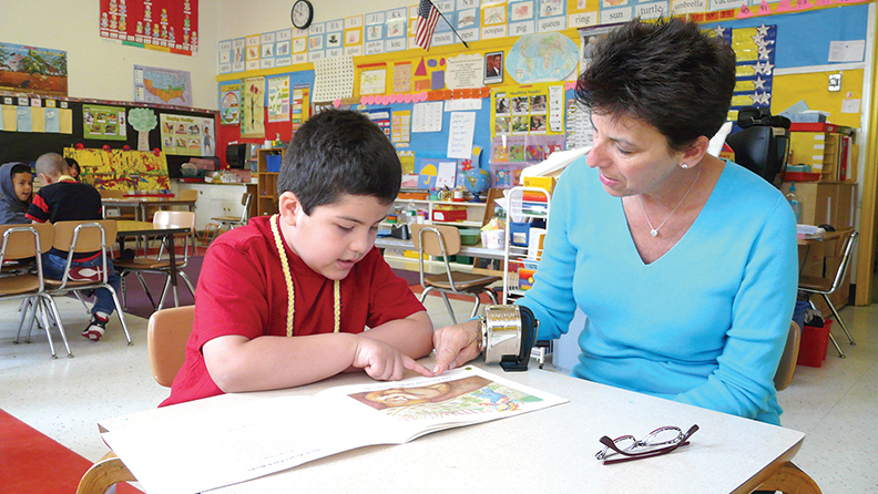 Bergen Reads volunteer Linda Palish helps a student — her buddy — learn to read.