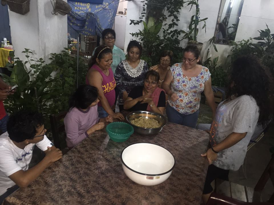 Rebeca Abramovitz, wife of the president of the Jewish community of Iquitos, Peru, prepares a traditional Peruvian pastry called 'bolitas' as members of the community watch, in this April 2015 photo. (Facebook)