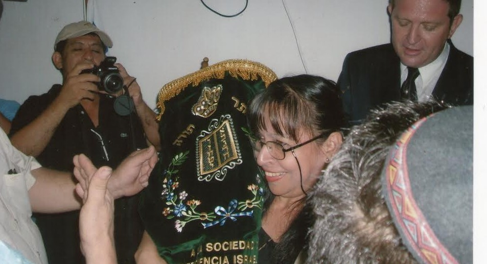 Rebeca Abramovitz holds the Iquitos Torah scroll in 2010. (Facebook)