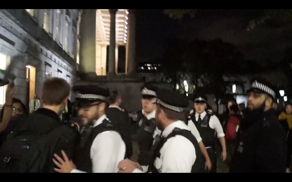 Police entering UCL, where the protesters disrupted the pro-Israel event.