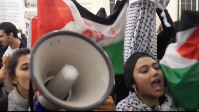 Demonstrators disrupting an event with Israeli speaker at UCL campus.