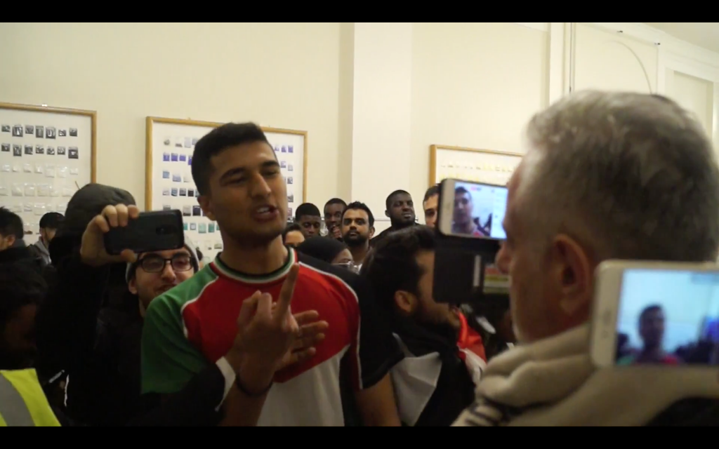 Pro and anti-Israel activists clashed inside the building where the meeting was taking place