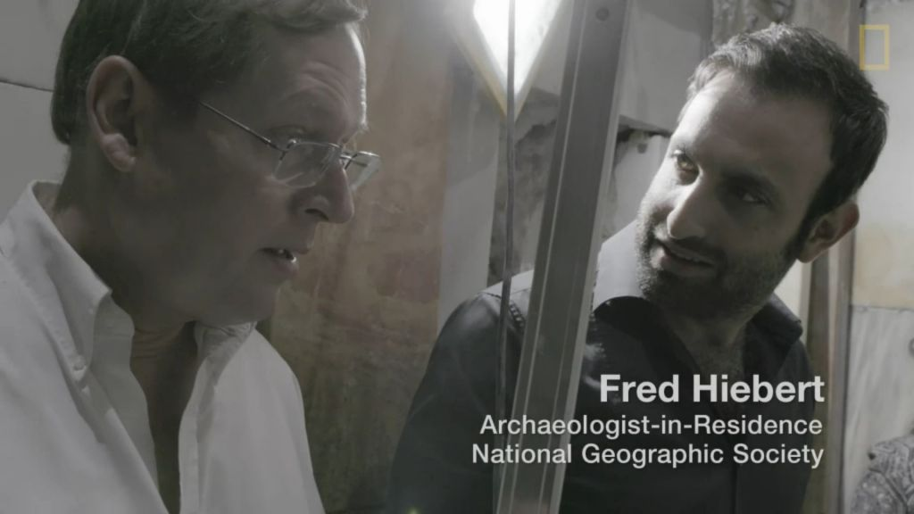 Fredrik Hiebert (left), National Geographic's archaeologist-in-residence, filmed at the tomb of Jesus, Church of the Holy Sepulchre, October 2016 (National Geographic screenshot)