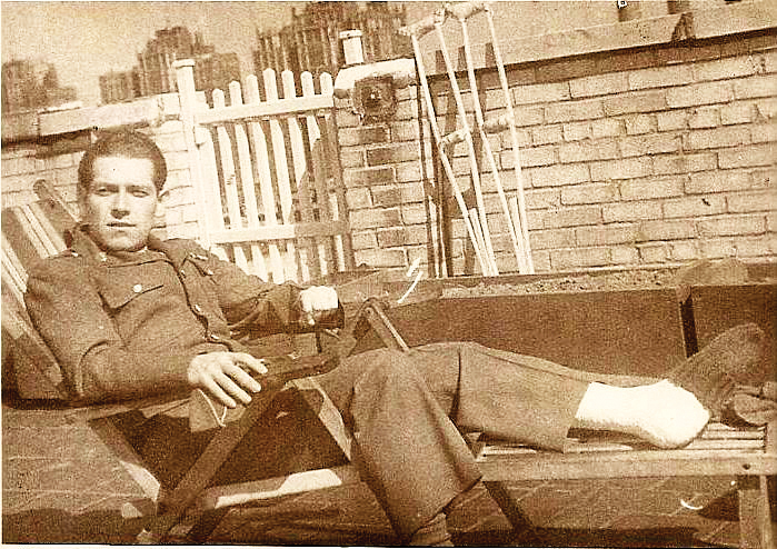 Jerome Selman, after the war; his crutches lean against the wall behind him.