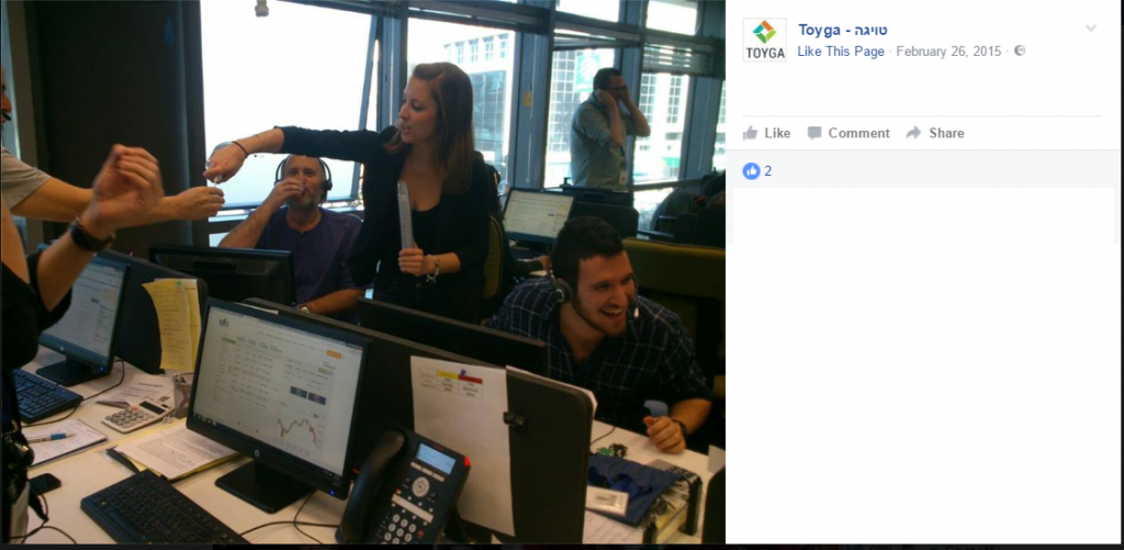 Inside Toyga: A screenshot from Toyga's Facebook page shows call center employees at computers with the brand UFX displayed (Screenshot).