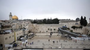 Visitors at the Western Wall in the Old City of Jerusalem on a rainy day, Oct. 25, 2015. JTA