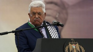 Palestinian Authority President Mahmoud Abbas speaking at a rally marking the 12th anniversary of the death of Yasser Arafat in Ramallah, November 10, 2016. (AFP/Abbas Momani)