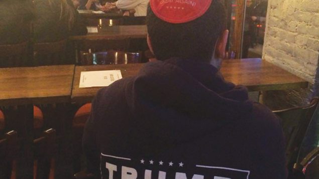 Jersey City resident Dustin Tropp, 23, dons a Trump kipa on election night.