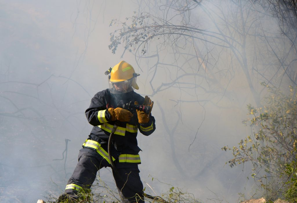 A fire fighter tackles the blaze