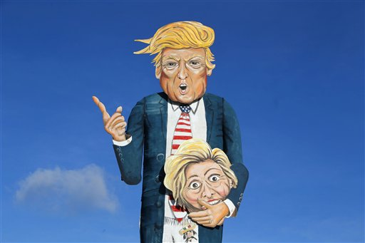 A view of the Edenbridge Bonfire Society effigy of Republican presidential hopeful Donald Trump holding the head of his rival Hillary Clinton, which was unveiled in Edenbridge in southern England on Nov. 2, 2016. (Gareth Fuller/PA via AP)