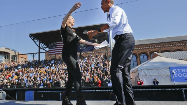Chelsea Clinton, left, prepares to embrace US President Barack Obama at the University of Michigan in Ann Arbor, Michigan, November 7, 2016, during a campaign rally for Chelsea's mother, Democratic presidential candidate Hillary Clinton. (AP /Pablo Martinez Monsivais)