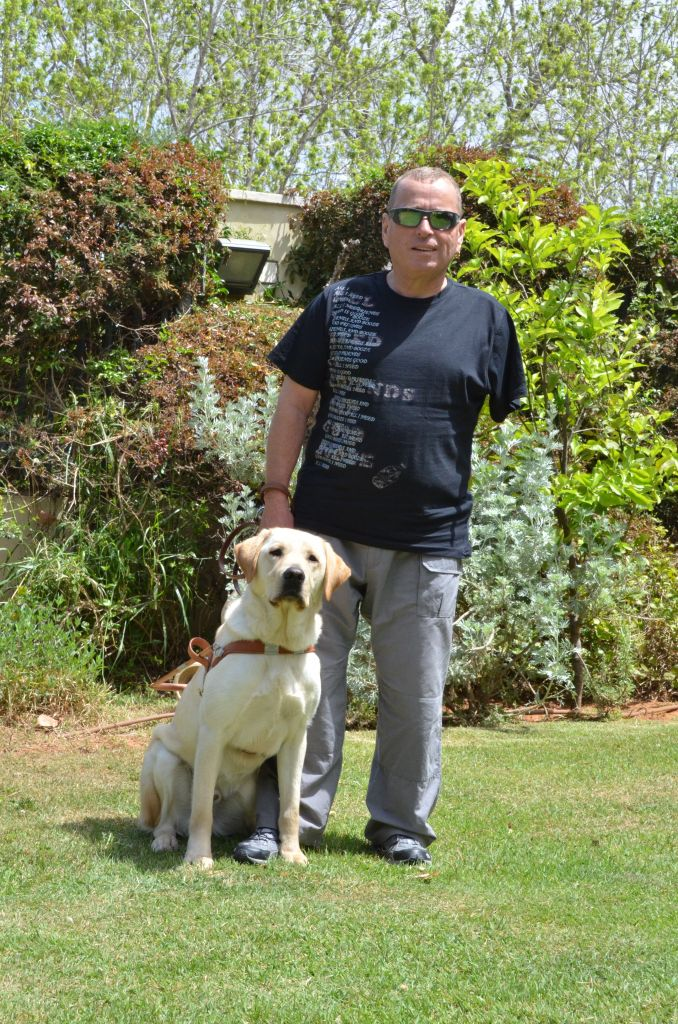 Eli Yablonek and Glen the guide dog who is part of his family