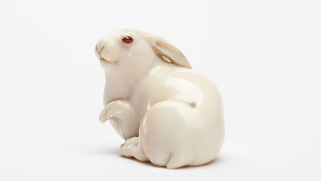 Ivory netsuke, the hare with amber eyes in the title of Edmund de Waal's family memoir. (Lostrobots CC BY-SA 4.0 via Wikimedia Commons)