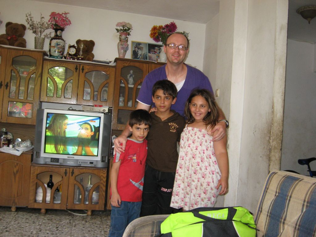 Miroslav stands with three of Galit Popok's children in a photograph taken in 2011, when the chemistry professor visited her home. (Credit: courtesy)