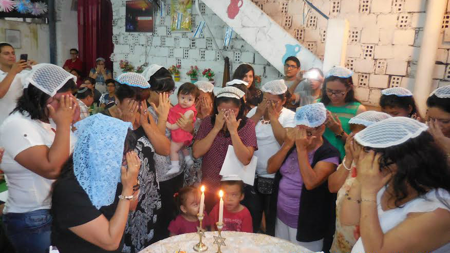 The Jewish community of Iquitos lights candles on Rosh Hashanah eve, 2016. (Facebook)