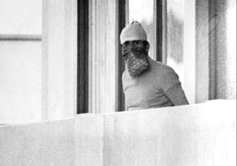 A masked terrorist appears at the window in the Olympic village.