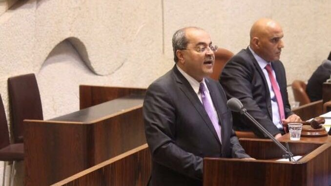 Joint List MK Ahmad Tibi sings the Muslim call to prayer on the podium of the Knesset on November 14, 2016. (Joint List)