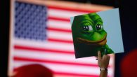 A Donald Trump supporter holding a poster of Pepe the Frog, which is designated a hate symbol by the Anti Defamation. JTA